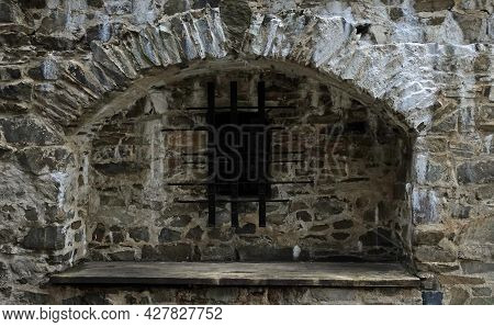 Barred Window In The Ruins Of The Stone Masonry Of The Castle Helfstyn