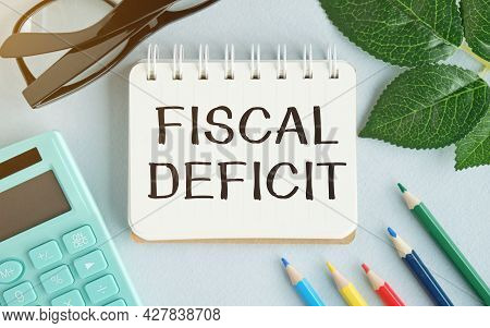 White Paper Card With Text Fiscal Deficit Sheet Of White Paper For Notes, Calculator, Hourglass In T