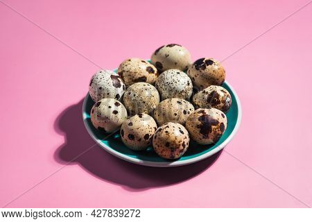 Quail Eggs And Green Small Plate On Pastel Pink Background. Minimal Happy Easter Composition. Minima