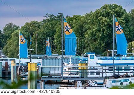 Berlin, Germany - July 10, 2019: Ships And Waving Flags Of Stern And Kreisschiffahrt Fleet At Wannse