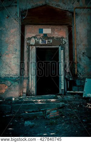 Scary Grunge Background In Horror Style, An Open Door Entrance To A Dangerous Staircase Of An Old Ho