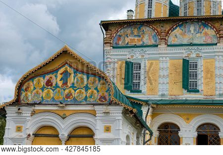 Frescoes On The Pediment. The Ancient Cathedral Of The Resurrection Of Christ Close Up On A Sunny Ju