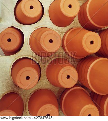 Brand New Terracotta Flower Pots Stored Upside Down In Cardboard Tray