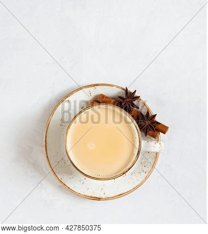 Masala Chai Tea On A White Concrete Background. Traditional Indian Drink With Spices And Milk. Copy