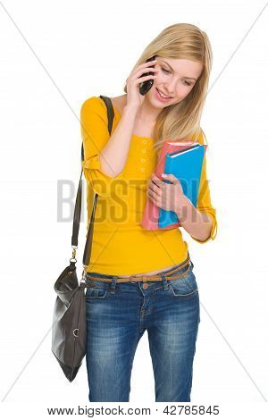 Happy student girl talking cell phone isolated on white poster