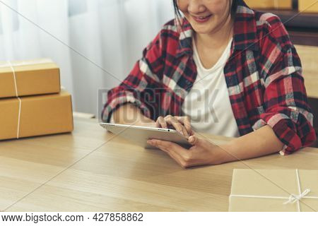 Asian Woman Startup Small Business At Home Office. Online Seller Entrepreneur Young Asian Woman Use