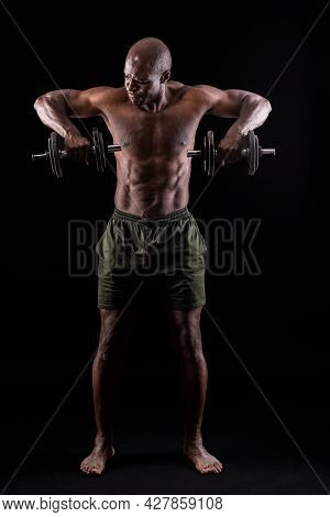 Front View Of A Muscular Man Standing Doing Triceps Exercise