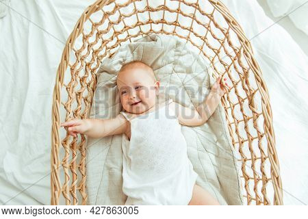 Closeup Portrait Of Cute Little Baby Boy Or Girl Laying In Wooden Crib. Beautiful Toddler Lying In B
