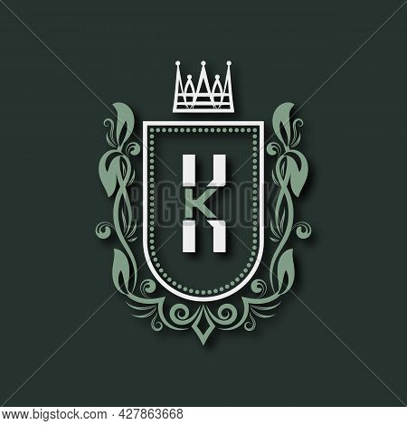 Vintage Premium Monogram Of Letter K. Heraldic Coat Of Arms In Form Of Shield Surrounded By Floral O