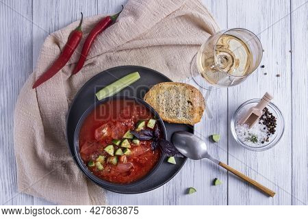 Top View A Bowl Of Spanish Traditional Cold Tomato And Cucumber Gazpacho Soup And A Glass Of White W