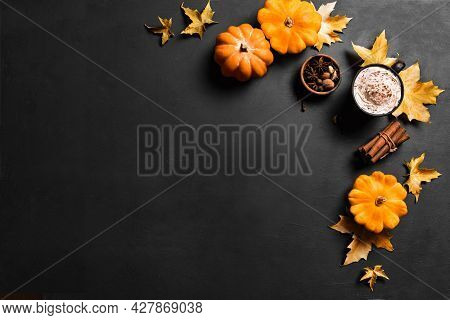 Autumn Composition With Pumpkins, Maple Leaves And Pumpkin Spice Latte Coffee On Black, Top View, Co