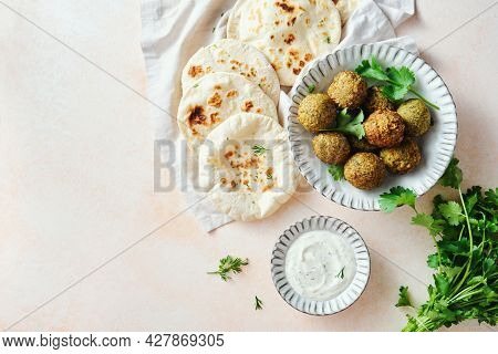 Homemade Falafel, Freshly Baked Pitas, Refreshing Sauce With Herbs. Middle Eastern Cuisine. Top View