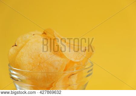 Potato Chips.chipsy.fast Food And Snack. Chips Close-up In A Glass Cup On A Yellow Background. Appet