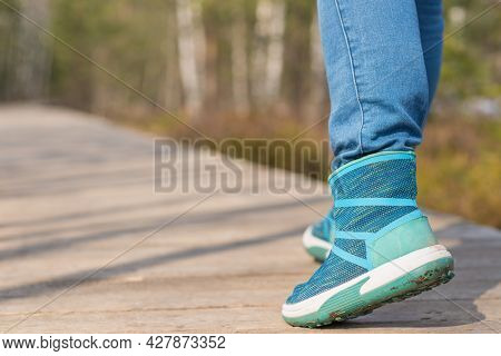 Woman Walk In To The Wild. Travel Adventure And Freedom Concept.woman Walking Outdoors, Shoes Closeu