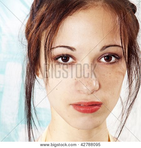 closeup girl's face with freckles, sight to camera