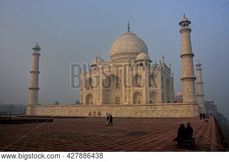 Taj Mahal In Early Morning Fog, Agra, Uttar Pradesh, India. It Was Built In 1632 By The Mughal Emper