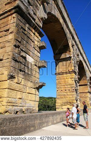 Nimes, France-july 20: Unidentified People Visit Aqueduct Pont Du Gard On July 20, 2015 Near Nimes,