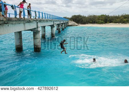 Ouvea, New Caledonia-january 8: Unidentified People Jump Off The Mouli Bridge Between Ouvea And Moul
