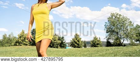 Summer Body In Shape. Fit Slim Woman In Yellow Dress. Thin Waist After Weight Loss And Fitness Diet.