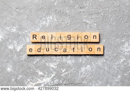 Religion Education Word Written On Wood Block. Religion Education Text On Cement Table For Your Desi