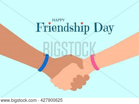 Happy Friendship Day Concept. The Hands Of Two Friends As They Hold Each Other. Blue And Pink Wristb