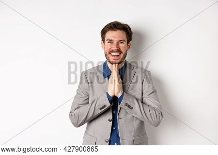 Happy Caucasian Businessman Say Thank You, Smiling And Laughing With Hands Showing Namaste Sign, Exp