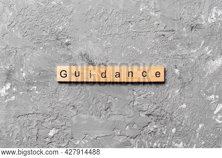 Guidance Word Written On Wood Block. Guidance Text On Table, Concept