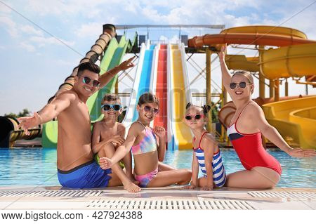 Happy Family At Poolside In Water Park
