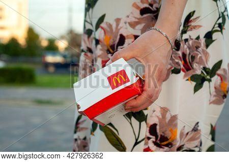Big Mac Box In Hand. A Box With A Mcdonald's Restaurant Logo. Minsk, Belarus - June, 2021