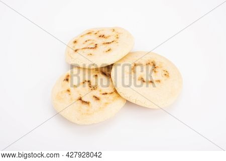 Stack Of Arepas Made With Corn Flour On A White Background, Typical Latin American Food. They Are Ge