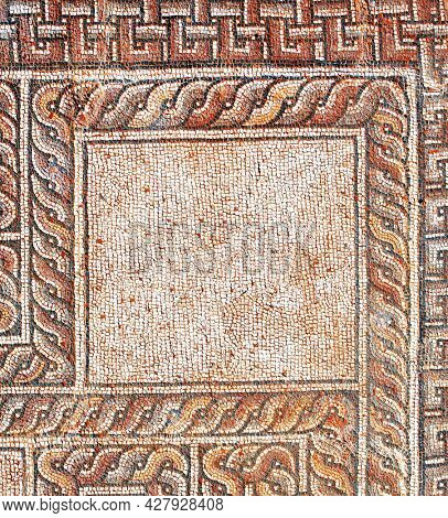 Detail of ancient mosaic. Decorative stone mosaic on floor in baths, Dion, Pieria, Greece. Mock up template. Copy space for text