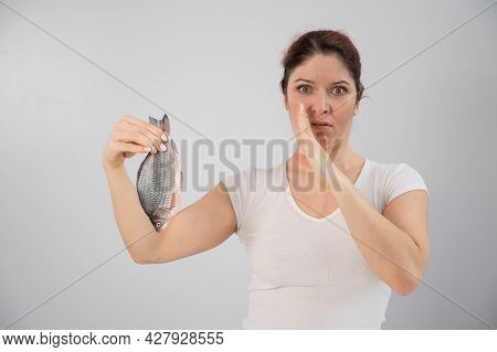 Caucasian Woman Opposes The Disgusting Smell Of Fish. A Metaphor For Womens Health And Intimate Hygi