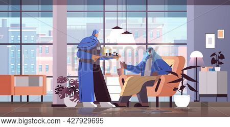 Friendly Arab Nurse Or Volunteer Bringing Pills To Arabic Elderly Man Patient Home Care Services Hea