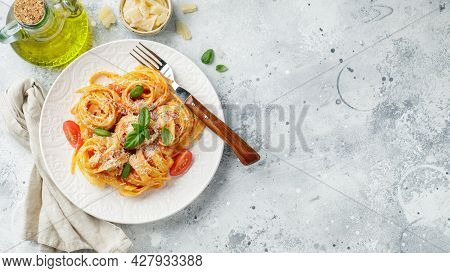 Tasty Appetizing Classic Italian Tagliatelle Pasta With Tomato Sauce, Cheese Parmesan And Basil On P