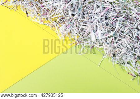 The Shredded Paper On Light Yellow And Green Background.