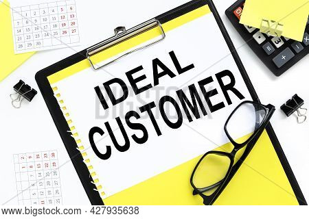 Ideal Customer. Text On Notepad Near Glasses