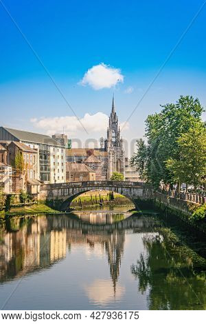 Parliament Bridge On River Lee And  Holy Trinity Roman Catholic Church On Sunny Summer Day