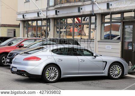 Haugesund, Norway - July 22, 2020: Porsche Panamera Hybrid Full Size Luxury Car Parked In Norway. Th