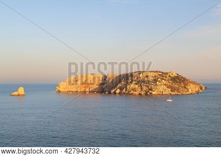 Landscape with Medes islands in sunset at the horizon