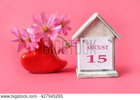 Calendar For: August 15 : The Name Of The Month Of August In English With The Number 15 On A Toy Hou