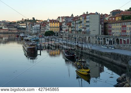Porto, Portugal - December 02, 2019: A Ribeira Zone At Sunrise In The Old Town Of Porto With The His