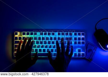 Hacker Steals Money Online. Hacker's Hands On The Keyboard With The Word: Hacker. Cyber Crime And On