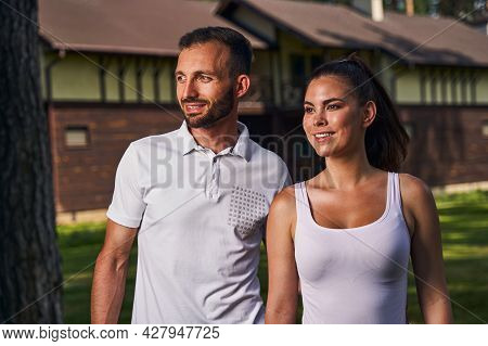 Beautiful Happy Romantic Young Couple Gazing Into The Distance