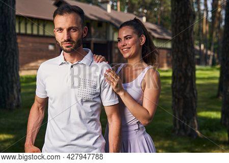 Calm Young Man Accompanied By His Beautiful Joyous Girlfriend