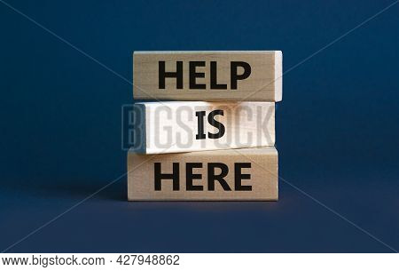 Help Is Here And Support Symbol. Wooden Blocks With Words 'help Is Here' On Beautiful Grey Backgroun