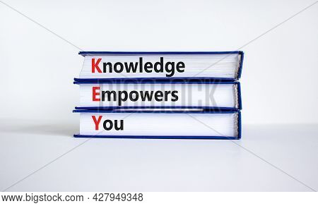 Key, Knowledge Empowers You Symbol. Books With Words 'key, Knowledge Empowers You'. Beautiful White