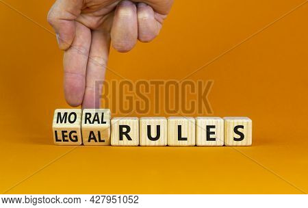 Legal Or Moral Rules Symbol. Businessman Turns Wooden Cubes And Changes Words 'legal Rules' To 'mora