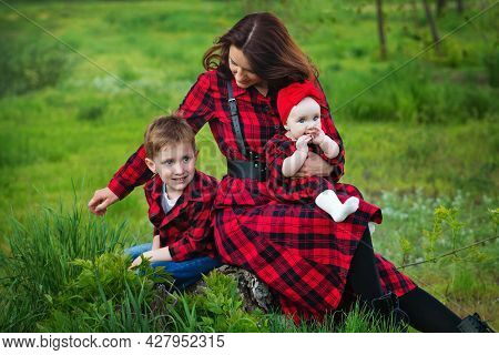 Happy Family Spend Time Together Outside In Green Nature. Single Mother With Children For Walk. Inte