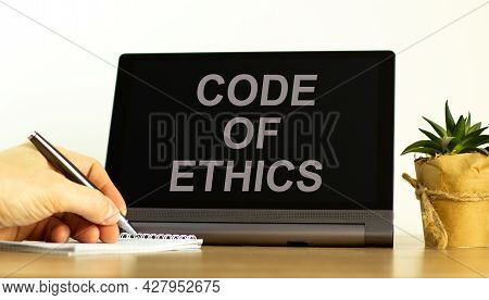 Code Of Ethics Symbol. Tablet With Words 'code Of Ethics'. Businessman Hand With Pen, House Plant. B
