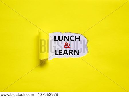 Lunch And Learn Symbol. Words 'lunch And Learn' Appearing Behind Torn Yellow Paper. Beautiful Yellow